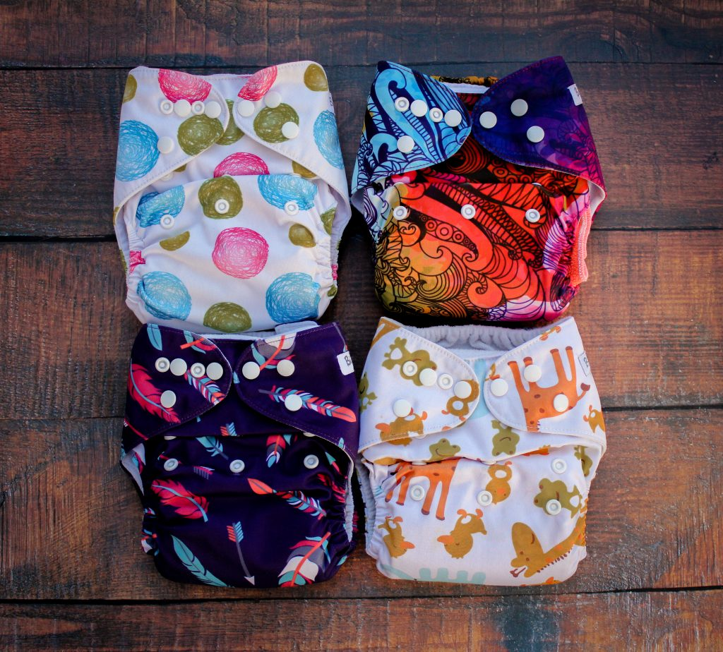four cloth pocket nappies marigolds and meat